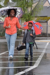 boy and mom in the rain